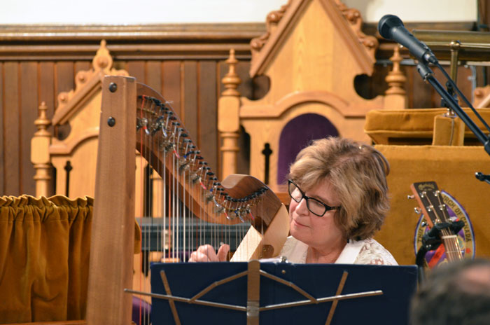 Grace Armstorng accompanied Marion Miller. Grace also sang a song while accompanying herself with her Irish harp.