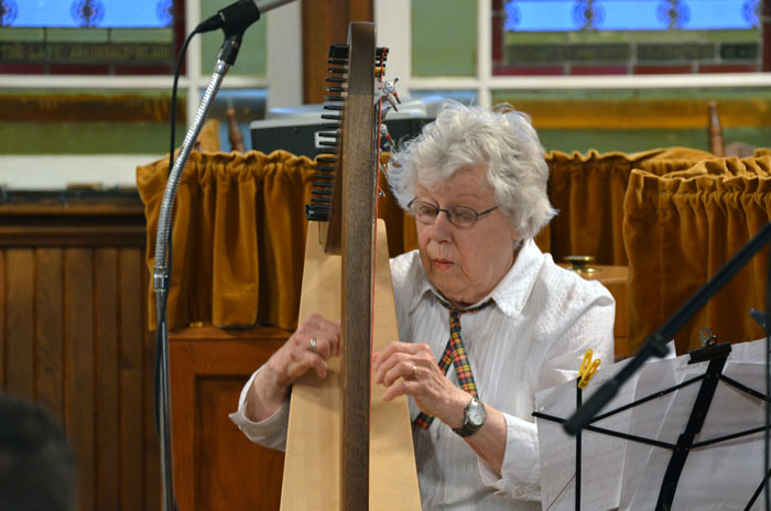 Marion Miller playing her locally constructed Irish harp.