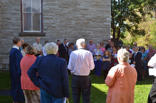 A view of part of the people attending the dedication of the addition to the church.