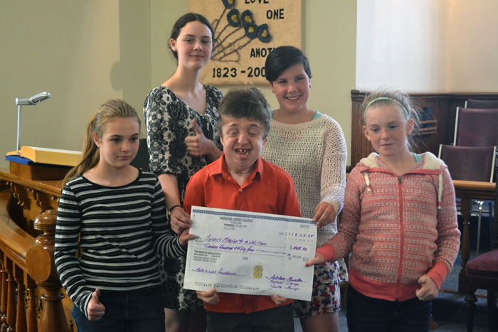 Members of the Youth Group present their cheque to Tysen for monies they earned<br />at various of the fund raising activities over the last few months.<br /> photo by Wayne Tubman