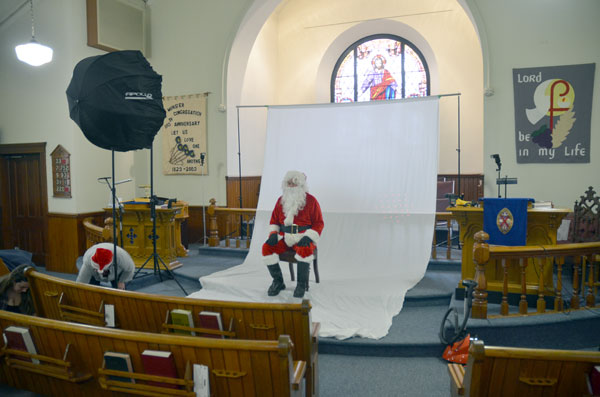 Final adjustments with Santa in his chair.